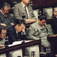 Snoozeville: Liberal Democratic Party lawmakers in the Lower House of the Diet pay little or no attention as Prime Minister Toshiki Kaifu, the leader of their party, addresses the opening session of the Diet in March 1990. | AP