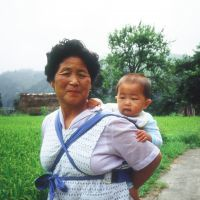 Country lives: Downer's 'beloved mother' (above) with her 'much-yearned-for baby' on her back in Yamanouchi, a village that the author describes in her 1989 book, 'On the Narrow Road to the Deep North'; and a melon-seller she met in Yamagata Prefecture during the making of a film based on that book. | PHOTOS COURTESY OF LESLEY DOWNER