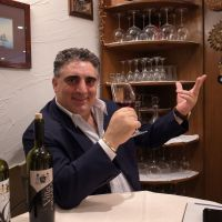 Grazie!: Elio Orsara samples a glass of new wine from his own vineyards at the dining room of his restaurant in Tokyo. | MICHAEL KLEINDL
