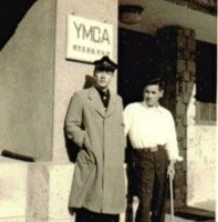 The young Yoshida poses with his brother Yuji (left) outside the YMCA building in Yokohama after taking part in an English speech contest.