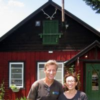 Diversified: Stefan Koester-Hirose poses with his wife, Kayoko, in front of their cafe in Biei, Hokkaido. | KRIS KOSAKA
