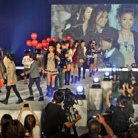 Screen tweens: Models wave to the cameras at Tokyo Top Kids Collection on Aug. 1, 2012. | YOSHIAKI MIURA
