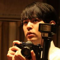 Behind the lens: Satoshi Tsumabuki as journalist Masami Sawada in 'My Back Pages' (2011). | &#169; 2011 