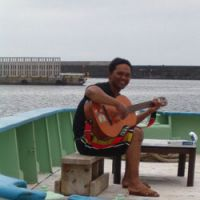Sea airs: An Indonesian crewman named Tofik aboard his offshore fishing boat in Yaizu, Shizuoka Prefecture. | HILLEL WRIGHT