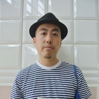 On record: Ryo Isobe, a freelance writer specializing in club music, holds his latest book titled 'Odotte wa Ikenai Kuni, Nihon (Japan: the Country Where You Must Not Dance).' | ERIKO ARITA