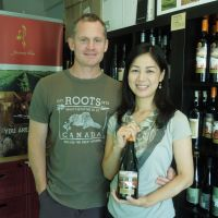 Cheers! Wine shop serves as a bridge for couple