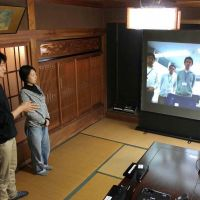 Long way from home: Employees of Internet startup Sansan, residing in a mountain  farmhouse in Tokushima Prefecture, confer with their colleagues at head office in Tokyo.