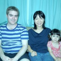 Family portrait: Dave and Mimari Greatbanks relax with Emma, their 2-year-old daughter, at their house in Yokohama. | MAMI MARUKO