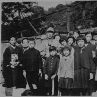 All together: Yoshiko Tatsumi (second from right, front row) with a group of family and friends on the day in 1937 when her father, Yoshio (center), was enlisted into the Imperial Army at the age of 41. He was afterward sent to serve in China. | YOSHIKO TATSUMI