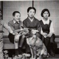 Home front: Yoshiko Tatsumi sits on the right by her mother, Hamako, in this snap from around 1940 that also shows her two brothers and the family's dog. | YOSHIKO TATSUMI