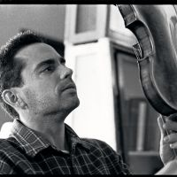 Virtuoso: 'Once you pass a certain point in your violin making, holding a Stradivarius or a fine Italian master make in your own hands, feeling it, looking into it — that is your best teacher,' says violin maker and dealer Louis Caporale, who divides much of his time between his two workshops in Tokyo. | MICHAEL DARNTON