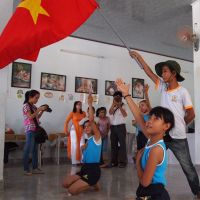 Flying the flag: Third-generation Agent Orange survivors at Da Nang's #3 Dioxin Center.