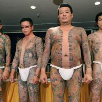 Gangster chic: Models show off works by tattooist Horiyoshii III at the Foreign Correspondents' Club in  Tokyo in May. | AFP-JIJI