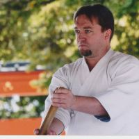 Sticks with it: Alex Bennett, demonstrating a classical kenjutsu at a shrine in Kyoto, says everything in his life has somehow been connected to kendo since encountering the martial art in his teens. | COURTESY OF ALEX BENNETT