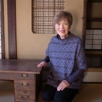 Preserving the past: Sumiko Enbutsu sits next to a suwarizukue writing desk in a room at Yasuda House in Tokyo's Bunkyo Ward. | MICHAEL KLEINDL