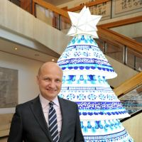 Seasonal cheer: Ambassador Jari Gustafsson stands in front of a display in the foyer of the Finnish Embassy in Tokyo's Shibuya Ward recently. The Christmas tree in the background &#8212; a combination of Nagoya 'chochin' (Japanese-style lantern) and Finnish patterns &#8212; was designed by Mai Ohta, a Japanese designer at Finnish textile and clothing company Marimekko. | YOSHIAKI MIURA