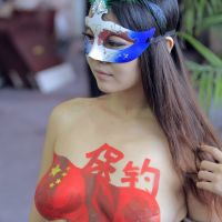 Getting it off her chest: A Chinese model shows off a body painting of the Diaoyu Islands, known as the Senkakus in Japan, in Nanjing in September. | AFP-JIJI