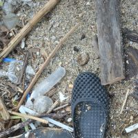 Plastic footwear is a major source of man-made pollution that washes up on the world's beaches. | AMY CHAVEZ