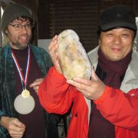 Have turnip will travel: Yoshio Otsuka (right) holds a rutabaga used in the 2011 International Rutabaga Curling Championship and kept frozen for a year, during his visit to Ithaca, New York, in late December. | PHOTOS COURTESY OF YOSHIO OTSUKA