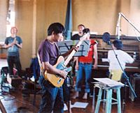 Tori Kudo of Maher Shalal Hash Baz at Dub Narcotic Studio in Olympia, Wash., recording the band's latest with some of the 19 musicians that appear on the album