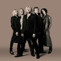 Live and kicking: Def Leppard aren't ready for the Zimmer frame just yet.