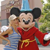 Hip chick: Christian Aguilera flolics with Mickey Mouse at the Diseny-MGM Studios, Florida, in 2007. | AP PHOTO