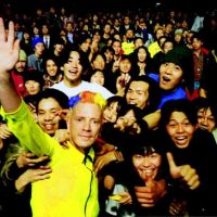 The man and his fans: John Lydon has his picture taken with fans in Tokyo when Sex Pistols played there in 1996. | JOHN LYDON PHOTO