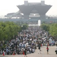 Fans of manga comic throng the sidewalks leading up to the Tokyo Big Sight awaiting to enter the Comic Marker expo. The 33-year-old event is acknowledged as the birthplace of Japan's cosplay (costume play) phenomena. | COMIC MARKET PREPARATIONS COMMITTEE
