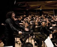 Eyes on the baton: Venezuelan maestro Gustavo Dudamel conducts the Simon Bolivar Youth Orchestra. Dudamel, 26, has been the SBYO's music director since age 18. (C) RAINER MAILLARD/DG