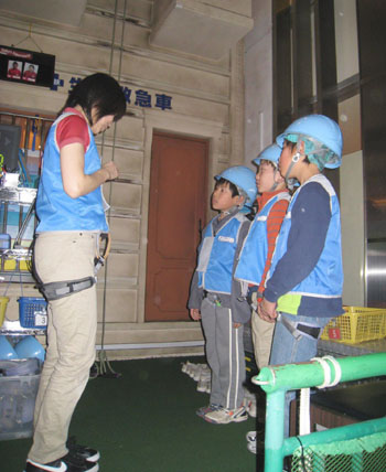Safety first: Children learn how to scale a building at the Kidzania theme park in Koto Ward, Tokyo.
