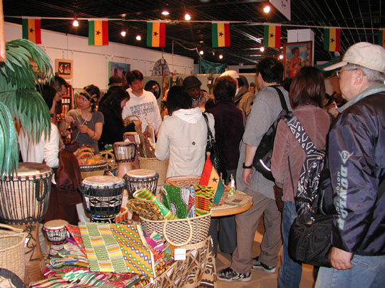 Cultural celebration: Attendees at the African Festival in Yokohama in 2009 peruse items on display at a market. This stall features goods from Ghana.