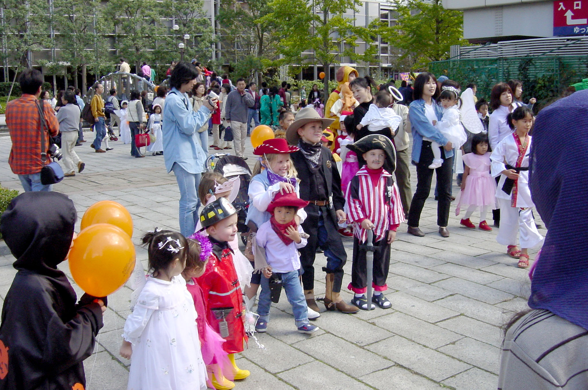 Bringing out the forces: Cowboys, cowgirls, pirates, princesses and a fireman get ready to party at Rokko Island Halloween in Kobe, Hyogo Prefecture.