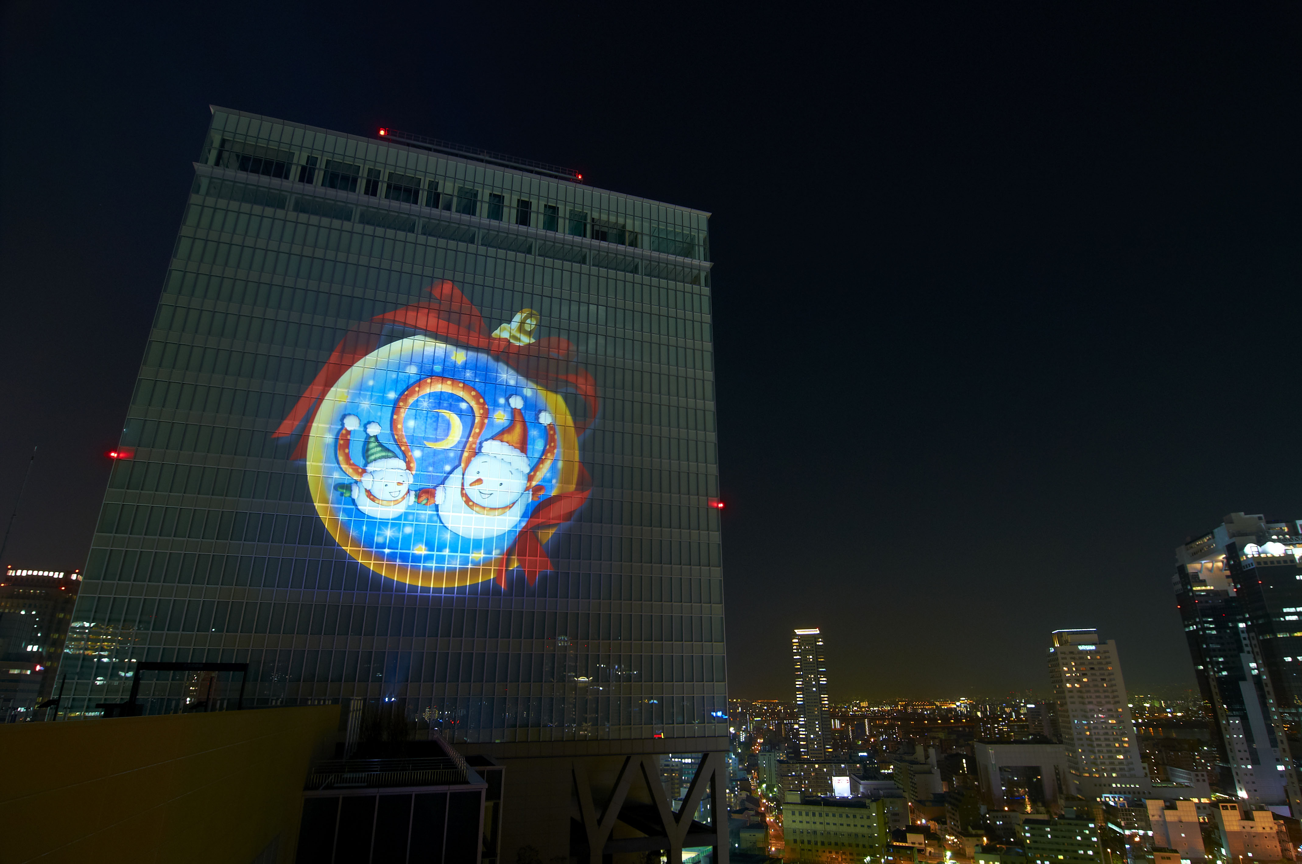 Frosty reception: Children's drawings are projected on the surface of Osaka Station's North Gate Building at last year's Umeda Snowman Festival.