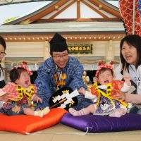 The crying game: Two toddlers battle it out through tears during Gokoku Shrine's annual naki-zumo (crying baby sumo) event. | GOKOKU SHRINE