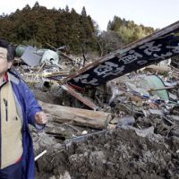 Sake brewer vows to rebuild after tsunami