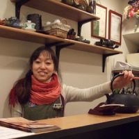 Proud owner: Yoshiko Kitagawa sits behind the counter of her first business.