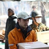 Helping hands: Peace Boat staffer Shingo Kobayashi delivers goods in Ishinomaki, Miyagi Prefecture, last week. | PEACE BOAT