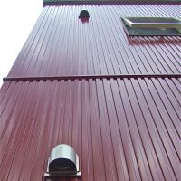 Cosmetic choices: Galvanium siding, samples of cement-fiber siding (below) and a recently painted mortar-and-tile exterior of a 1975 house (bottom). | PHILIP BRASOR AND MASAKO TSUBUKU