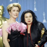 Actress Catherine Deneuve with Eiko Ishioka, who holds her Oscar for best costume design for 'Bram Stoker's Dracula' at the 65th annual Academy Awards in Los Angeles, 1992. Ishioka died of pancreatic caner on Jan. 21, at age 73. | AP/KYODO