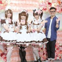 Service with all the frills: High-end fashion designer Keita Maruyama poses with three @Home Cafe maids dressed wearing new uniforms that he designed.
