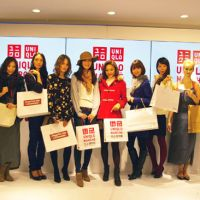 Brand new: Models line up in front of the new Uniqlo Marche that opened in Tokyo's ritzy Ginza district on Nov. 2.