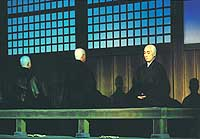 In the hall of meditation, Dogen and Ejo practice zazen.