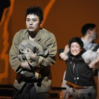 Volcanic performance: Actors Satoshi Tsumabuki and Yu Aoi (background) take part in a dress rehearsal for Hideki Noda's 'To the South.' The play tackles the subject of Japanese identity. | YOSHIAKI MIURA PHOTO