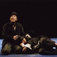 Life friends: Vladimir (Isao Hashizume) lets an exhausted Estragon (Saburo Ishikura) rest against his knee in 'Waiting for Godot' at the New National Theatre, Tokyo. | (C) MASAHIKO YAKOU
