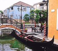 A gondola in Jiyugaoka's 'Little Venice' retail area and restaurant Tateno with some of its collection of signs.