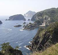 The southernmost tip of Izu is Irozaki (above). Views of the rocky coastline can also be seen from this suspended bridge near Dogashima, on Izu's western coast (below). Fresh sashimi, meanwhile, can be sampled anywhere across the peninsula. | MARIKO KATO PHOTOS