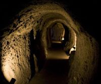 History's depths: The main tunnel of the Ryugenji Shaft (above), part of the World Heritage-listed Iwami Ginzan silver mine. Below: Wooden beams that once supported working platforms for miners can still be seen in the Okubo Shaft. | PERRIN LINDELAUF PHOTOS