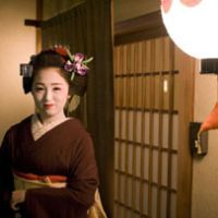Ichimame, a maiko, stands outside an elite restaurant in the Kami Shichiken geisha district of Kyoto. | PERRIN LINDELAUF PHOTOS