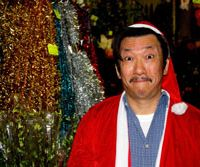 Christmas spirit: Yoshiharu Sanou, manager of winter-decorations shop Sekisho Masuya, rocks a Santa Claus look. Below: Taniguchi offers high quality traditional Japanese paper. | KIT NAGAMURA PHOTOS