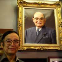 Double takes: Michio Matsuo poses in front of his father's portrait. Below: Reiko Kogure enjoys Katsuhiko Fujisaki's lively remembrances at La Palette restaurant. Bottom: Fukuya aesthetic salon's fortune-beckoning cat collection.